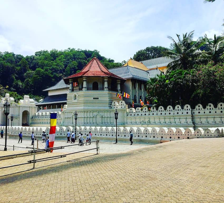 Things to do in Kandy with kids - The Temple of the Tooth on the shores of Kandy's lake