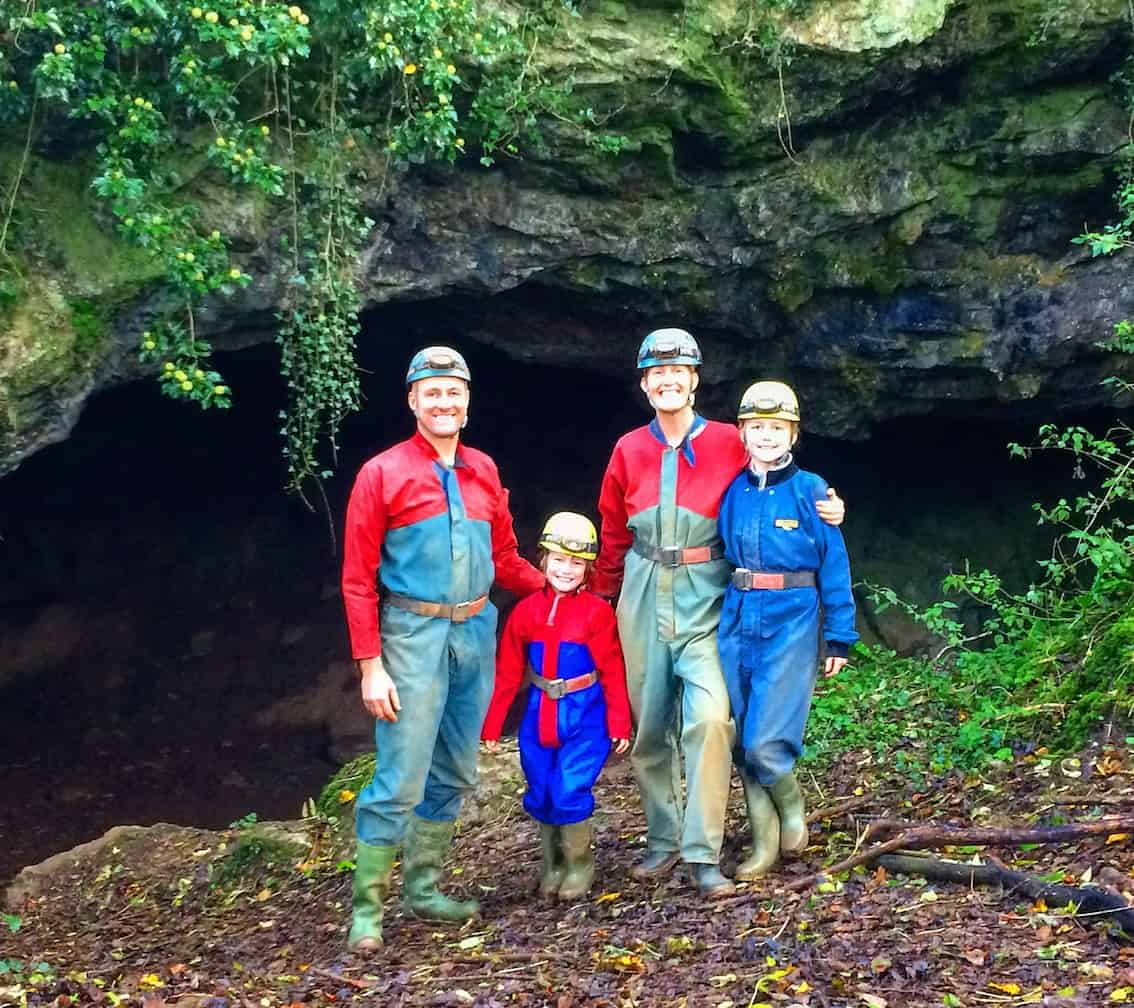 family caving experience - before descent in clean overalls