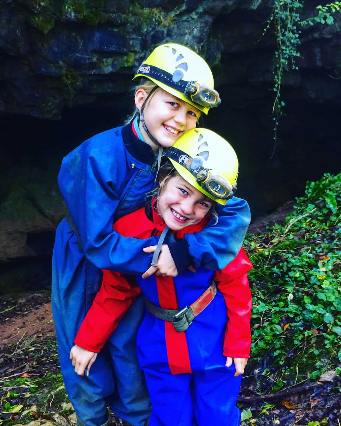 caving in devon. kids dressed in caving gear